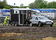 © Licensed to London News Pictures. 11/05/2012. Windsor, UK People struggle to push a car and horse box through the deep mud. The public car parks for the show have been closed until the weekend. The Royal Windsor Horse Show in Windsor, England on May 11 2012. Photo credit : Stephen Simpson/LNP