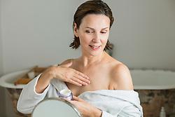 Woman Applying Moisturiser on Cleavage