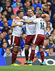 Burnley's Sam Vokes (centre) celebrates scoring his side's first goal of the game