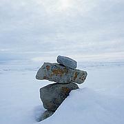 Canada, Nunavut Territory, Inukshuk, or Inuit landmarks along shores of the town of Igloolik.