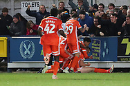 Shrewsbury Town defender Luke Waterfall (22) celebrating after scoring goal to make it 1-2 during the EFL Sky Bet League 1 match between AFC Wimbledon and Shrewsbury Town at the Cherry Red Records Stadium, Kingston, England on 3 November 2018.