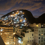 A contrast between the hotels complete with swimming pools at Copacabana beach and the favela Morro dos Cabritos just behind Copacabana beach, Rio de Janeiro, Brazil. 19th July 2010. Photo Tim Clayton