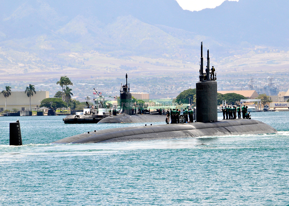 PEARL HARBOR (Sept. 5, 2013) The Los Angeles-class attack submarine USS Tucson (SSN 770), foreground, passes the Virginia-class attack submarine USS Hawaii (SSN 776) as Tucson departs Joint Base Pearl Harbor-Hickam for a deployment to the western Pacific region.  (U.S Navy photo by Mass Communication Specialist 2nd Class Steven Khor/Released) 130905-N-DB801-268<br /> Join the conversation<br /> http://www.navy.mil/viewGallery.asp<br /> http://www.facebook.com/USNavy<br /> http://www.twitter.com/USNavy<br /> http://navylive.dodlive.mil<br /> http://pinterest.com<br /> https://plus.google.com