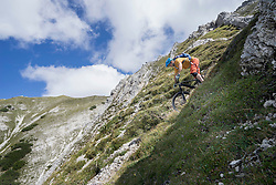 Mountain biker riding downhill, Tirol, Austria