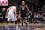 DALLAS, TX - JANUARY 7: Troy Caupain #10 of the Cincinnati Bearcats brings the ball up court against the SMU Mustangs on January 7, 2016 at Moody Coliseum in Dallas, Texas.  (Photo by Cooper Neill/Getty Images) *** Local Caption *** Troy Caupain