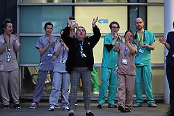 Staff from the Royal Liverpool University Hospital join in a national applause during Thursday's nationwide Clap for Carers NHS initiative to applaud NHS workers fighting the coronavirus pandemic.
