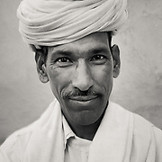Portrait of Bishnoi man in traditional clothing near village of Chandelao, Rajistan