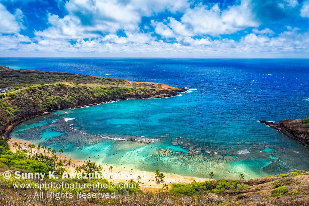 Aerial view of Hanauma Bay and Pacific Ocean under blue sky. Honolulu, Oahu Island, Hawaii.