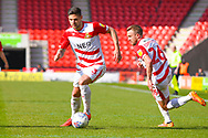 Danny Andrew of Doncaster Rovers (3) and James Coppinger of Doncaster Rovers (26) in action during the EFL Sky Bet League 1 match between Doncaster Rovers and Plymouth Argyle at the Keepmoat Stadium, Doncaster, England on 13 April 2019.