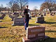 22 NOVEMBER 2019 - DES MOINES, IOWA: A U.S. Marine Corps bugler plays Taps at the reinterment service of US Marine Corps Reserve Private Channing Whitaker. Whitaker died in the Battle of Tarawa on Nov. 22, 1943. He was buried on Betio Island, in the Gilbert Islands, and his remains were recovered in March 2019. He was identified by a DNA match with surviving family members in Iowa. Whitaker was reintered in the Glendale Cemetery in Des Moines exactly 76 years after his death in World War Two. About 1,000 US Marines and sailers were killed in four days during the Battle of Tarawa.           PHOTO BY JACK KURTZ