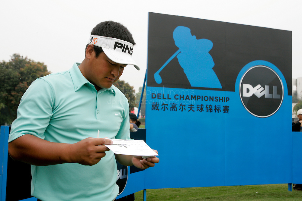 XIAMEN, CHINA - MARCH 21:  Kong Weihai of China looks over his score card during 3rd round action of the Dell Championship at the Orient (Xiamen) Golf and Country Club on March 21, 2009 in Xiamen, China. A record number of entries of 132 players are competing for the RMB 1 million prize money.  (Photo by David  Paul Morris/ WSG)