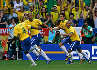 Photo: Glyn Thomas.<br />Brazil v Australia. Group F, FIFA World Cup 2006. 18/06/2006.<br /> Brazil's Adriano (second from L) celebrates giving his team a 1-0 lead.