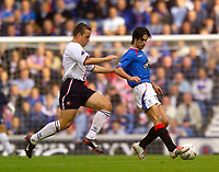 Photo. Jed Wee.<br /> Glasgow Rangers v Dundee, Scottish Premier League, Ibrox, Glasgow. 27/09/2003.<br /> Rangers' Mikel Arteta (R) with Dundee's Gavin Rae.