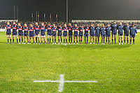 USA's players, sing their national anthem before the rugby test match between Romania and USA, on National Stadium Arc de Triomphe in Bucharest, November 8, 2014. Romania lose the match against USA, final score 17-27.