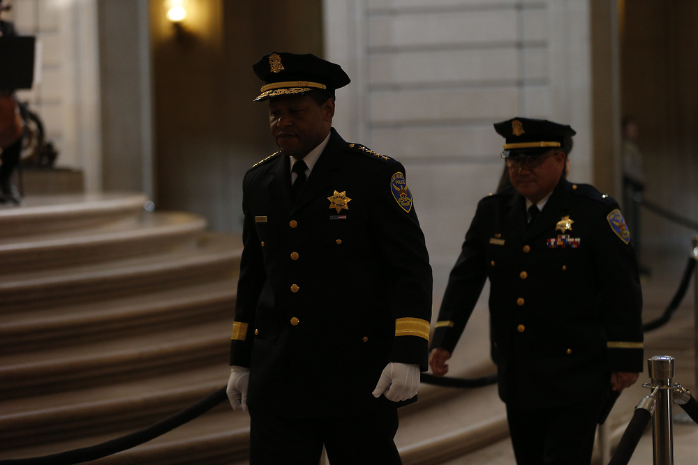 San Francisco Police Chief Bill Scott (left) pays his respect as San Francisco Mayor Ed Lee lies in state at City Hall on Friday, Dec. 15, 2017, in San Francisco, Calif. Lee died on Tuesday from a heart attack. He was 65 years old.