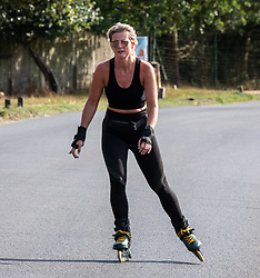 """© Licensed to London News Pictures. 12/09/2020. Surrey, UK. A roller skater enjoys the glorious sunshine in Richmond Park in South West London this afternoon before the """"Rule of 6"""" comes into force on Monday as weather experts announce a 6 day mini heatwave in the South East of England this week with highs in excess of 29c. Prime Minister Boris Johnson is already under pressure after he announced on Friday that gatherings of more than six people will be banned from Monday in the hope of reducing the coronavirus R number. The Rule of Six as it is known, has already become unpopular with MPs and large families. Photo credit: Alex Lentati/LNP"""