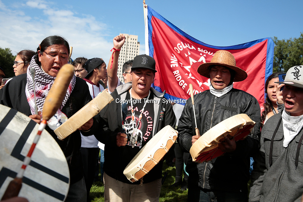 Opponents of the Dakota Access oil pipeline sing during a rally on the North Dakota capitol grounds on September 9, 2016. Bismarck, North Dakota, United States.