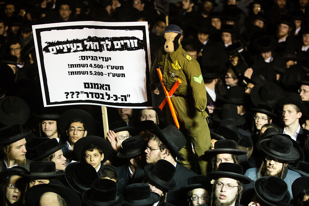 Ultra-Orthodox Jews attend a protest against recruitment to the Israeli army, expressing their opposition to new amendments in the contentious Equal Service law, at the Mea Shearim neighborhood of Jerusalem, Israel, on December 22, 2015. In November, Israeli lawmakers approved an amendment to the Equal Service law, which dramatically rolled back the 2014 reforms on ultra-Orthodox recruitment into the Israel Defense Forces and scrapped the communal penalties imposed if annual quotas for ultra-orthodox soldiers were not met.