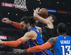 March 8, 2019 - Los Angeles, California, United States of America - Danilo Gallinari #8 of the Los Angeles Clippers goes over Steven Adams #12 of the Oklahoma Thunder during their NBA game on Friday March 8, 2019 at the Staples Center in Los Angeles, California. Clippers defeat Thunder, 118-110.  JAVIER ROJAS/PI (Credit Image: © Prensa Internacional via ZUMA Wire)