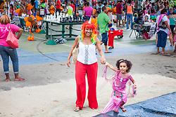 Mermaid Arielle Shackell pulls her unicorn mom, Michael Holt, along.  Virgin Islands Montessori School and Peter Gruber International Academy hosts Fall Fest 2015.  St. Thomas, USVI.  31 October 2015.  © Aisha-Zakiya Boyd