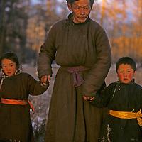 MONGOLIA, Darhad Valley. Migrating herder & his grandchildren.