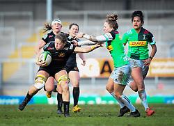 Kate Zackary of Exeter Chiefs hands off Emily Scott of Harlequins - Mandatory by-line: Andy Watts/JMP - 06/02/2021 - Sandy Park - Exeter, England - Exeter Chiefs Women v Harlequins Women - Allianz Premier 15s
