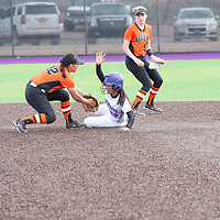 Miyamura Patriots shortstop Lakisha Shorty (20) slides safely into second base after a late tag by Aztec Tigers second baseman April Trujillo (32). The Tigers won 17-7 in the first game of the double header at Miyamura High School on Friday.