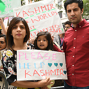 Hundreds Kashmiris protest India terrorists and Indian army occupation revoke article 370 and 35A. The same language Israel apartheid in Palestine outside India Embassy London, THow can a human being harm this beautiful children? on 20 August 2019, UK.