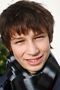 Portrait close up of smiling young teenage boy, UK