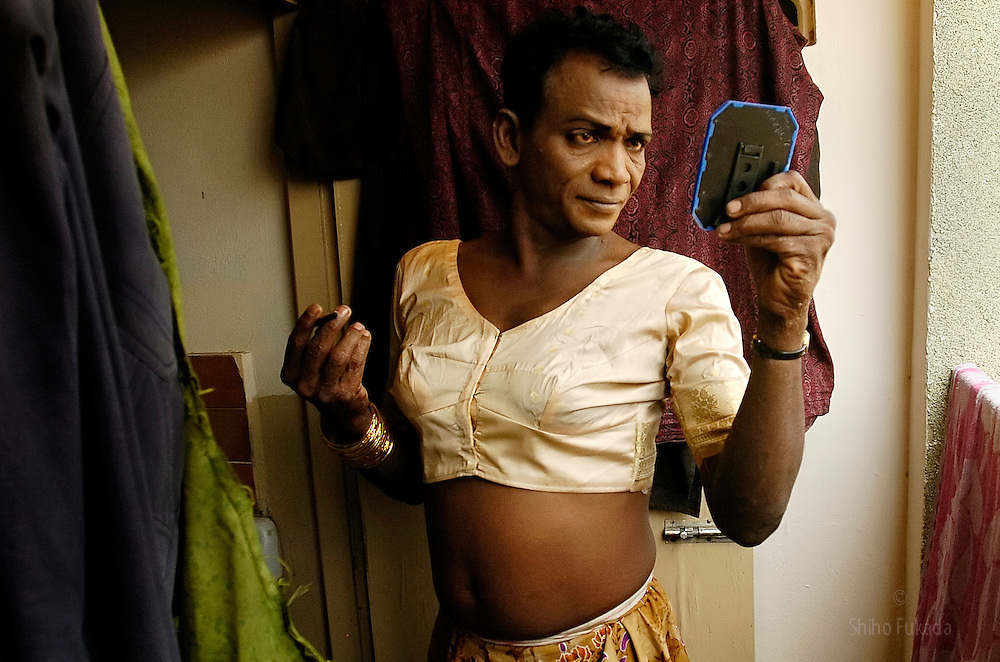 """A transgender puts on makeup in Villupuram, India. <br /> As transgenders,""""hijras"""" in local terms, are acutely marginalized in Indian society, the major earning avenues for them are sex work, begging and performing at rituals."""
