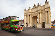 A tourist bus in front of the Brandenburg gate in Potsdam, Brandenburg, Germany.
