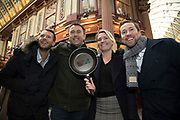 Shrove Tuesday festivities as The City Flippers, celebrate winning the Leadenhall Market Pancake Day Race on 13th February 2018 in London, United Kingdom. Competing teams of City workers outside The Lamb Tavern tackle the 25m course, competing to win the coveted frying pan trophy as they flip their way around the historic 14th century market.
