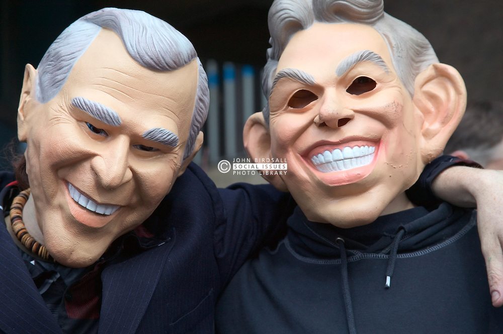 Friends of the Earth supporters wearing masks representing political leaders during protest,