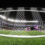 Liverpool goalkeeper Simon Mignolet saves a penalty from Jesús Navas, Manchester City, during the Manchester City Vs Liverpool FC Guinness International Champions Cup match at Yankee Stadium, The Bronx, New York, USA. 30th July 2014. Photo Tim Clayton