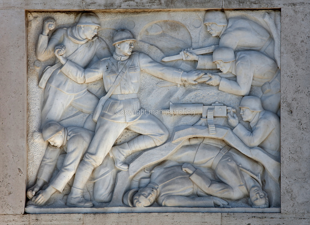 Relief of soldiers fighting by Vico Consorti, 1902-79, on the Ponte Duca d'Aosta, built 1939-42 in Fascist style by Vincenzo Fasolo, a bridge linking Lungotevere Flaminio to Piazza Lauro De Bosis, near the Foro Italico, Rome, Italy. Fascist architecture developed in the late 1920s and 1930s, as a modernist style in times of nationalism and totalitarianism under Benito Mussolini. It is characterised by large, square, symmetrical buildings with little or no decoration, often inspired by ancient Rome and designed to convey strength and power. Picture by Manuel Cohen