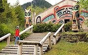 USA, Alaska, A man explores Saxman Totem Park two miles south of Ketchikan on Revillagigedo Island.MR