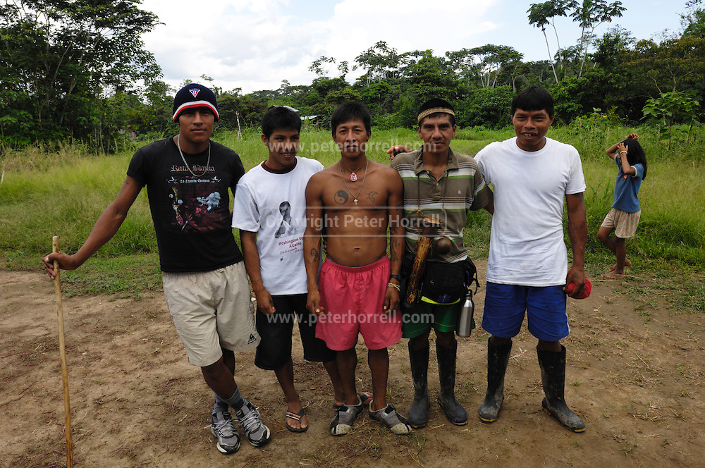 Ecuador, May 6 2010: Huaorani men pose for a photo. Copyright 2010 Peter Horrell