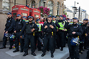 Police surround demonstrators gathered to oppose the Free Tommy Robinson demonstration, organised by anti-fascist groups including Stand up to Racism opposed to far right politics on 24th August 2019 in London, United Kingdom. Some 250 Stand Up To Racism and other anti-fascist groups took to the streets today in opposition to supporters of jailed 'Tommy Robinson' real name Stephen Yaxley-Lennon at Oxford Circus, who gathered outside the BBC.