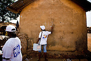 A health worker marks a house with chalk to indicate that children have been vaccinated during a national polio immunization exercise in Salaga, northern Ghana on Thursday March 26, 2009.