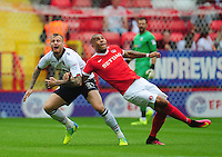 Bolton Wanderers' Mark Beevers is fouled by Charlton Athletic's Josh Magennis<br /> <br /> Photographer Kevin Barnes/CameraSport<br /> <br /> The EFL Sky Bet League One - Charlton Athletic v Bolton Wanderers - Saturday 27 August 2016 - The Valley - London<br /> <br /> World Copyright © 2016 CameraSport. All rights reserved. 43 Linden Ave. Countesthorpe. Leicester. England. LE8 5PG - Tel: +44 (0) 116 277 4147 - admin@camerasport.com - www.camerasport.com