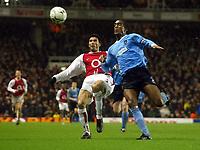 Photo: Scott Heavey.<br /> Arsenal v Manchester City. FA Barclaycard Premiership. 01/02/2004.<br /> Jose Reyes (L) attempts to tackle Sylvain Distin