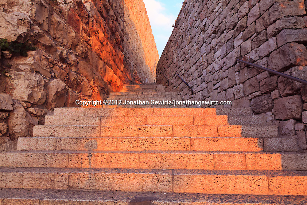 Pedestrian entrance to Hativat Etzioni Street as it crosses Mount Zion along the southern wall of the Old City of Jerusalem. WATERMARKS WILL NOT APPEAR ON PRINTS OR LICENSED IMAGES.