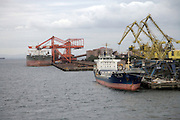 commercial cargo ships docked in Tokyo harbor