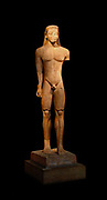Statue of a kouros.  Naxian marble, found in Sounion.  The statue was a votive offering to Poseidon and stood before his temple.  Its over-life-size scale is striking and testifies to the tendency of early Archaic sculptors to create impressive colossal statues, about 600 BC.