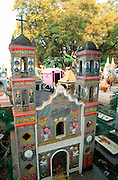 MEXICO, COLONIAL CITIES, OCOTEPEC Cemetery just east of Cuernavaca with tombs built as small churches, an example of popular folk art