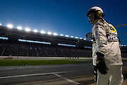 A NASCAR official stands in pit row during the Sprint Cup NRA 500 at Texas Motor Speedway in Fort Worth on Saturday, April 13, 2013. (Cooper Neill/The Dallas Morning News)