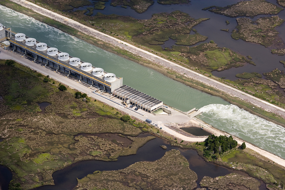A channel lined with cooling units collects water that was used to cool the thermoelectric power plant and moves it out toward the Gulf beyond coastal wetlands.