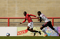 Football - 2020 / 2021 Sky Bet League Two - Morecambe vs. Bolton Wanderers<br /> <br /> Carlos Mendes Gomes of Morecambe carries the ball away from Ricardo Almeido Santos of Bolton Wanderers, at the Mazuma Stadium.<br /> <br /> COLORSPORT/ALAN MARTIN