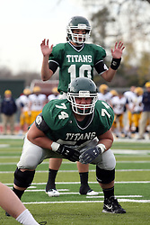 12 November 2011:  Jeremy Adams and Rob Gallik thane their places in the offensive formation during an NCAA division 3 football game between the Augustana Vikings and the Illinois Wesleyan Titans in Tucci Stadium on Wilder Field, Bloomington IL