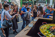 Visitors are happily tempted by tasters - The market reopening is signified by the ringing of the bell and is attended by Mayor Sadiq Khan. Tourists and locals soon flood back to bring the area back to life. London 14 Jun 2017